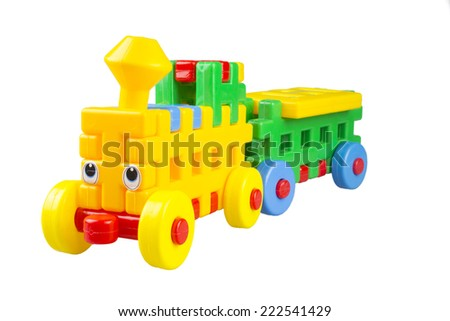 Plastic toy train on a white background - stock photo