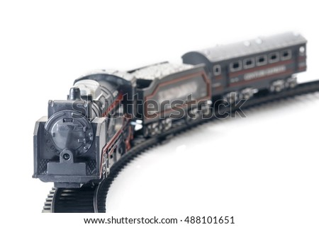Plastic toy, view of vintage train on white table.