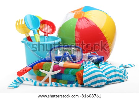 Plastic toys and diving equipment with swimming suit on white background. - stock photo