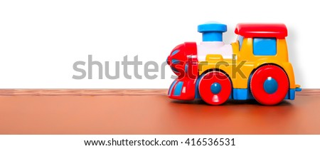 plastic train on the floor in a playroom - stock photo