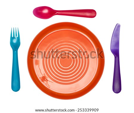 Plastic ware: a orange plate, a blue fork, a red spoon, the violet knife isolated on the white - stock photo