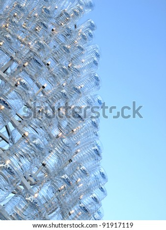 Plastic water bottles and light bulbs. - stock photo