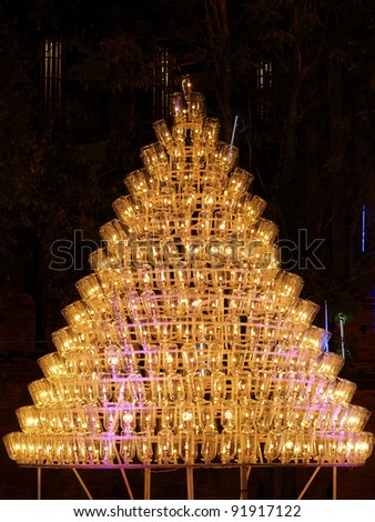 Plastic water bottles and light bulbs, Christmas tree - stock photo