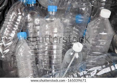 Plastic water bottles in the trash heap - stock photo