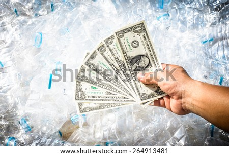 Plastic water Bottles or Garbage become to money also save the world ,a good business from garbage - stock photo