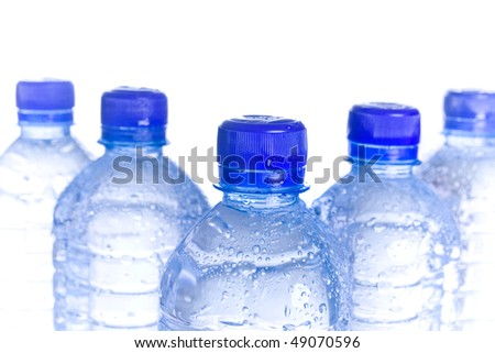 Plastic water bottles with blue cap reflecting. - stock photo