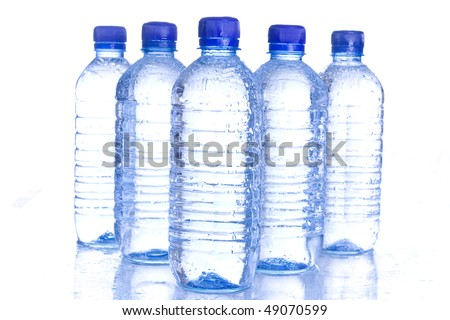 Plastic water bottles with blue cap reflecting.