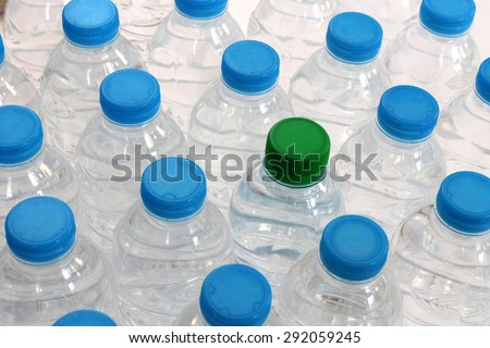 plastic water bottles with blue caps and green cap