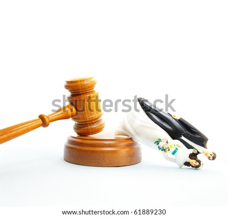 plastic wedding couple and legal gavel (divorce concept) - stock photo