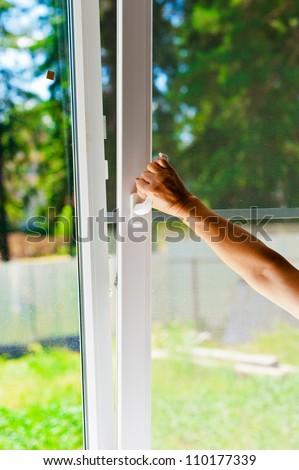 plastic window with mosquito net - stock photo