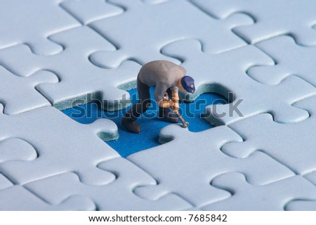 plastic worker fixing a puzzle