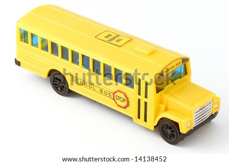 plastic yellow toy school bus on white background - stock photo