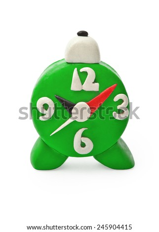 Plasticine alarm clock on white background - stock photo