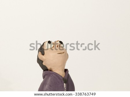 Plasticine character. Boy looking up - stock photo