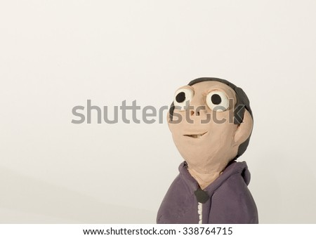 Plasticine character. Boy with hoodie - stock photo