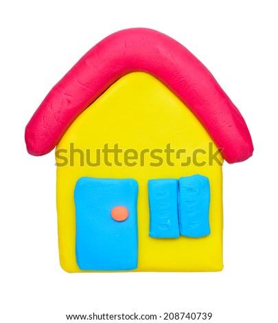 plasticine clay house on white background - stock photo
