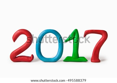"Plasticine figures ""2017"" on a white background"