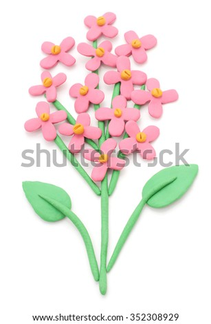 Plasticine flower isolated on a white background. - stock photo