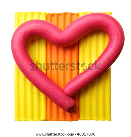 Plasticine heart isolated over the white background - stock photo