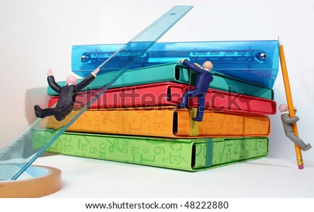 Plasticine human figures humorously handling office objects on white background