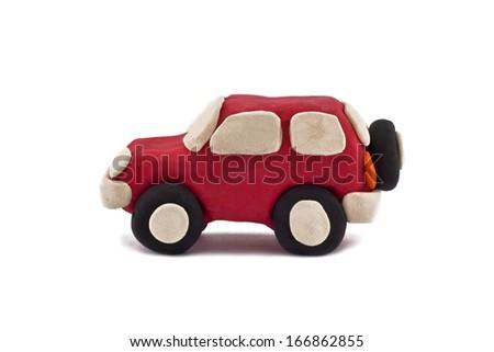 plasticine jeep isolated on white background - stock photo