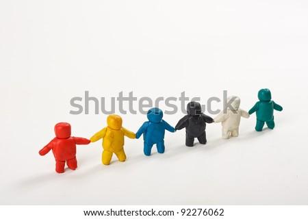 plasticine little men stand in a row - stock photo