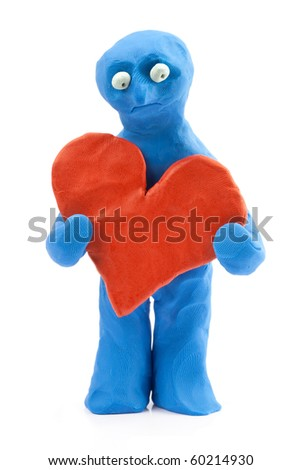 plasticine man with a big heart - stock photo