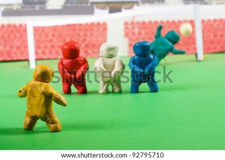 Plasticine people. Football scene. - stock photo