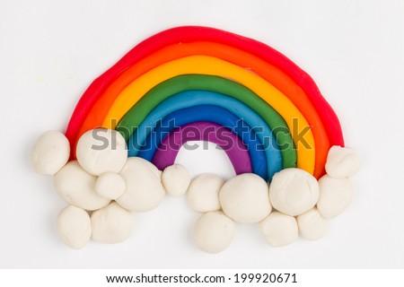 Plasticine rainbow, clouds - Stock Image macro. - stock photo