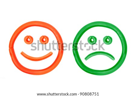 plasticine smiling and crying faces - stock photo