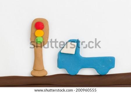 Plasticine traffic light and car from children bright plasticine - Stock Image macro. - stock photo