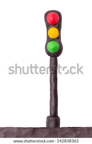 Plasticine traffic light on a white background - stock photo