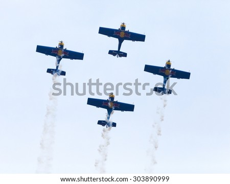 "PLASY, CZECH REPUBLIC-APRIL 27, 2013: Flying Bulls Aerobatics Team on the Airshow ""The Day on Air"". Team fly four Zli­n Z-50 LX aircraft, in the colors of Red Bull energy drink for sponsorship reasons - stock photo"