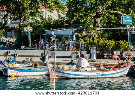 PLATAMON, GREECE - MAY 13, 2016: Harbor with boats and fishing schooners. Platamonas (Greek) is a sea-side resort and fishermans village in south Pireia, Central Macedonia.