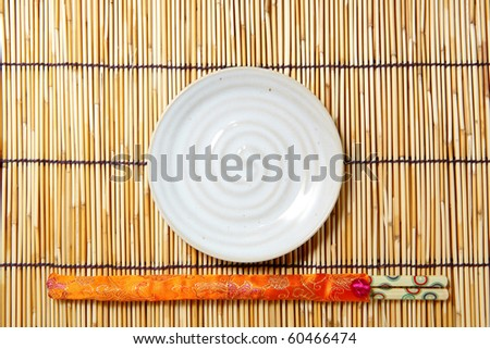 plate and chopsticks - stock photo