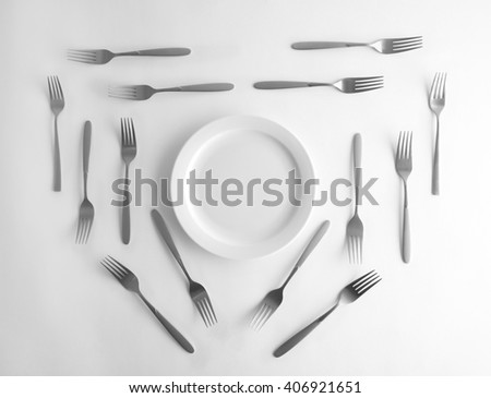 Plate and silver forks, top view - stock photo