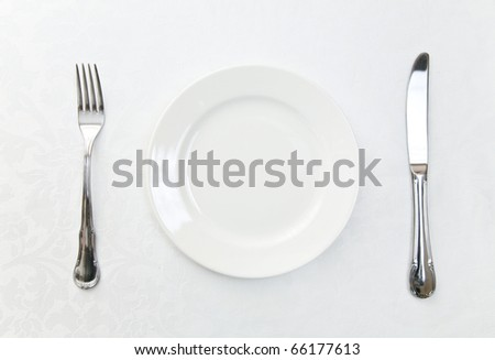 Plate and silverware - stock photo
