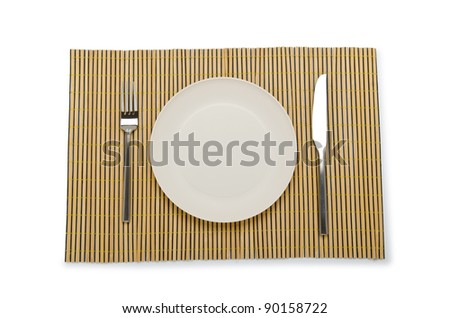 Plate and utensils served on table - stock photo