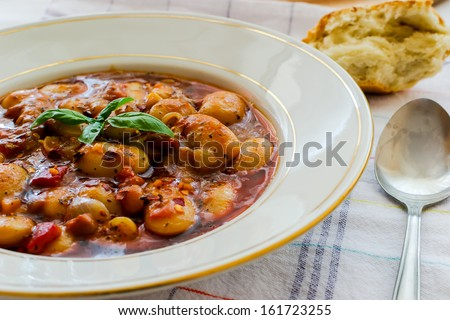 Plate bean stew with vegetables and fresh homemade bread