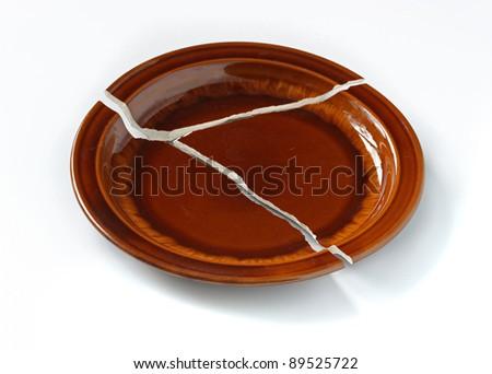 Plate broken into three parts. - stock photo