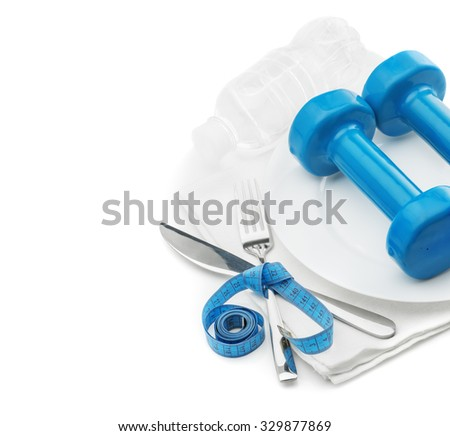 Plate, dumbbells, centimeters, knife, fork and a bottle of water isolated on a white background, the concept of fitness, a healthy diet, weight loss - stock photo