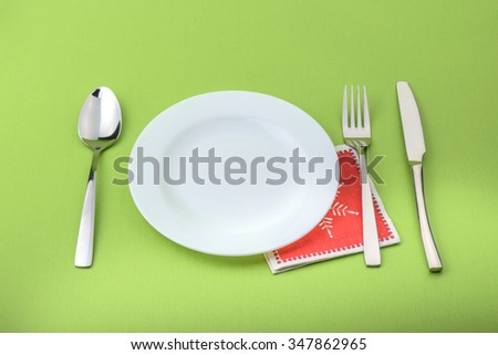Plate fork and knife in a christmas napkin