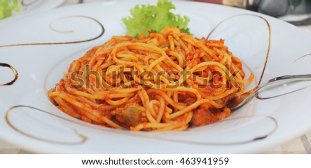 Plate from spaghetti with tomato sauce and seafood