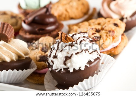 plate full of an assortment of cookies and mini brownie bites - stock photo