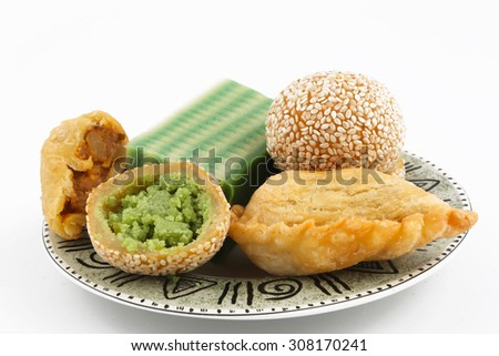 Plate full of asian traditional dessert or snack on white background - stock photo