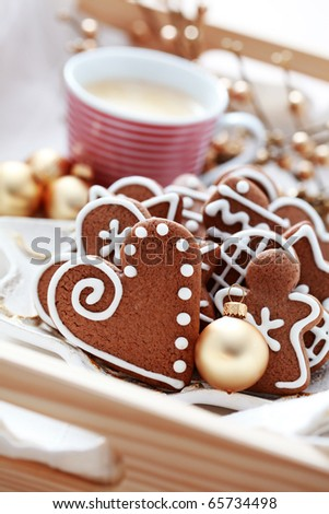 plate full of Christmas gingerbreads and cup of coffee - sweet food - stock photo