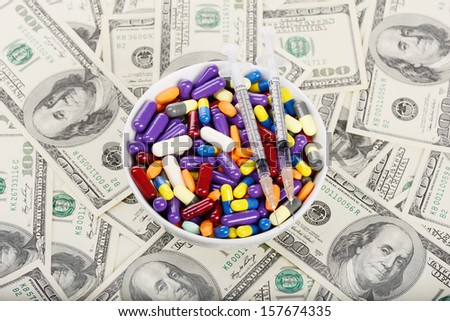Plate full of pills, tablets and syringes  (installation on the theme of modern medicine trends) - stock photo