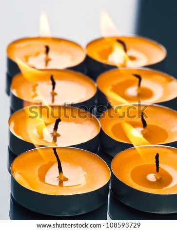 plate groups candles shine in the darkness - stock photo