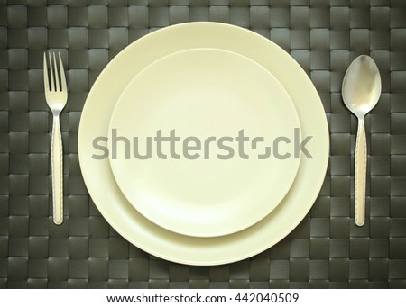 Plate mat with fork and knife for background