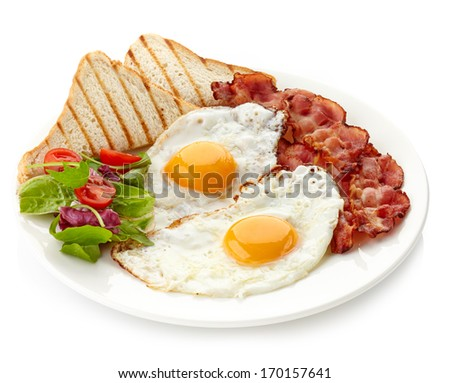 Plate of breakfast with fried eggs, bacon and toasts - stock photo